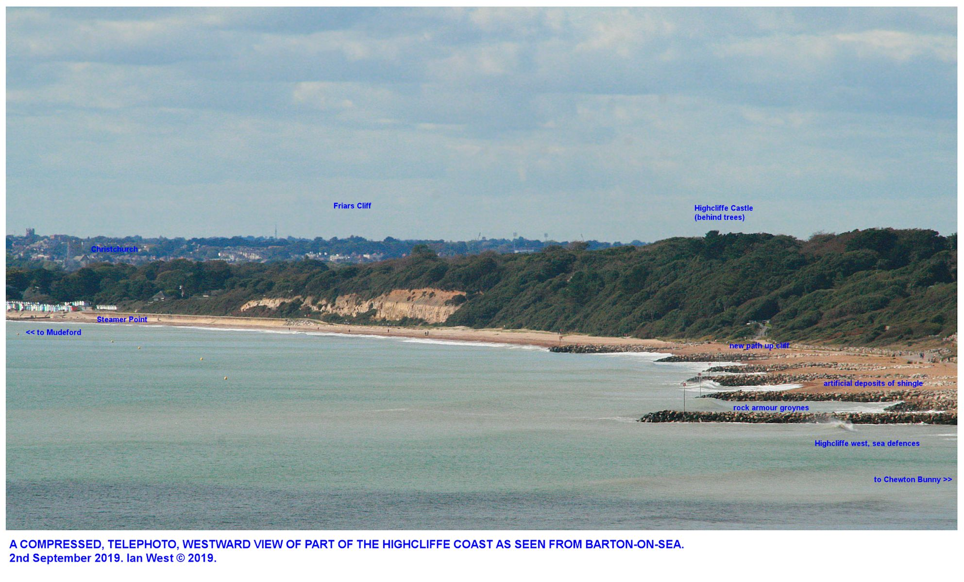 A distant view from Barton-on-Sea of Highcliffe groynes, the forested cliffs near Highcliffe Castle, and Friars Cliff etc. as seen on the 2nd October 2019, by Ian West