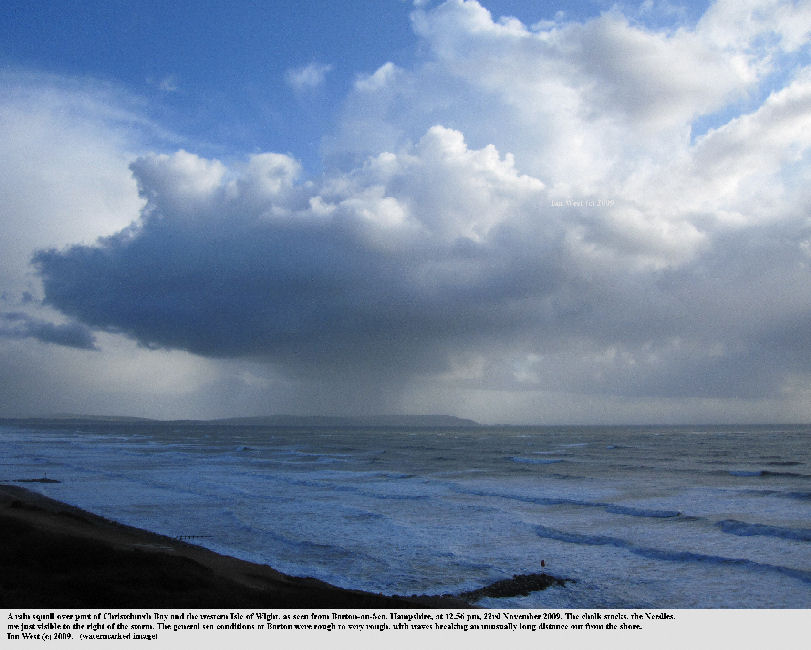 A rain squall over the western part of the Isle of Wight seen from Barton-on-Sea, Hampshire, November 2009