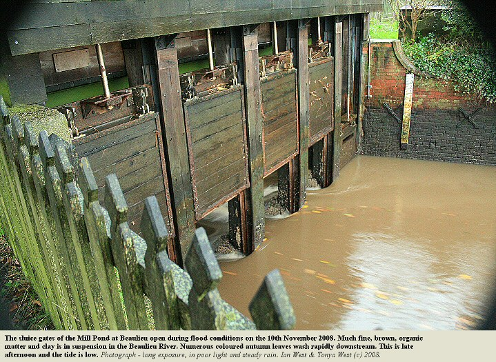 Sluice gates open during river flood conditions and low tide at the southern end of the Mill Pond, Beaulieu, Hampshire, 10th November 2008