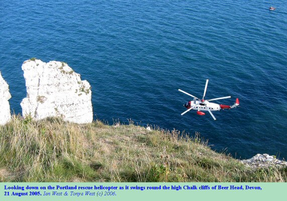View from the high cliff top at Beer Head, East Devon, with the rescue helicopter passing below