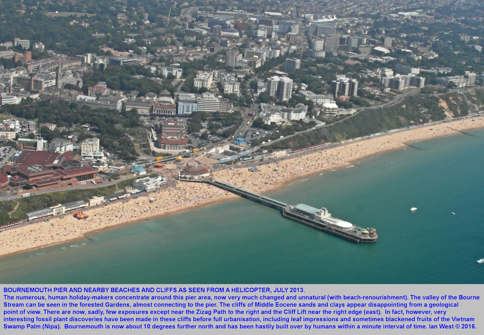 A general helicopter view of Bournemouth Pier and adjacent coast, showing overgrown cliffs of Eocene sand and clay, 6th July 2013