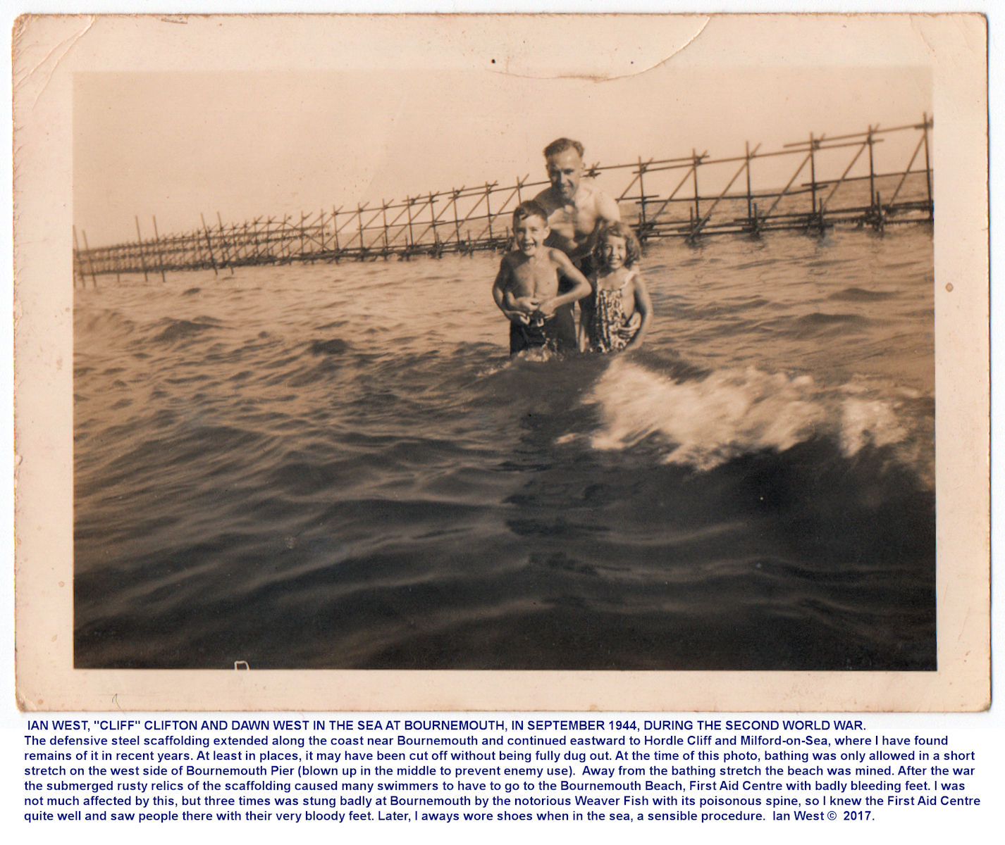Bournemouth Beach, just west of the Pier, in September 1944 during the Second World War, with Ian West and family members in the sea, just landward of the scaffolding sea defences that were widespread on the coast at the time