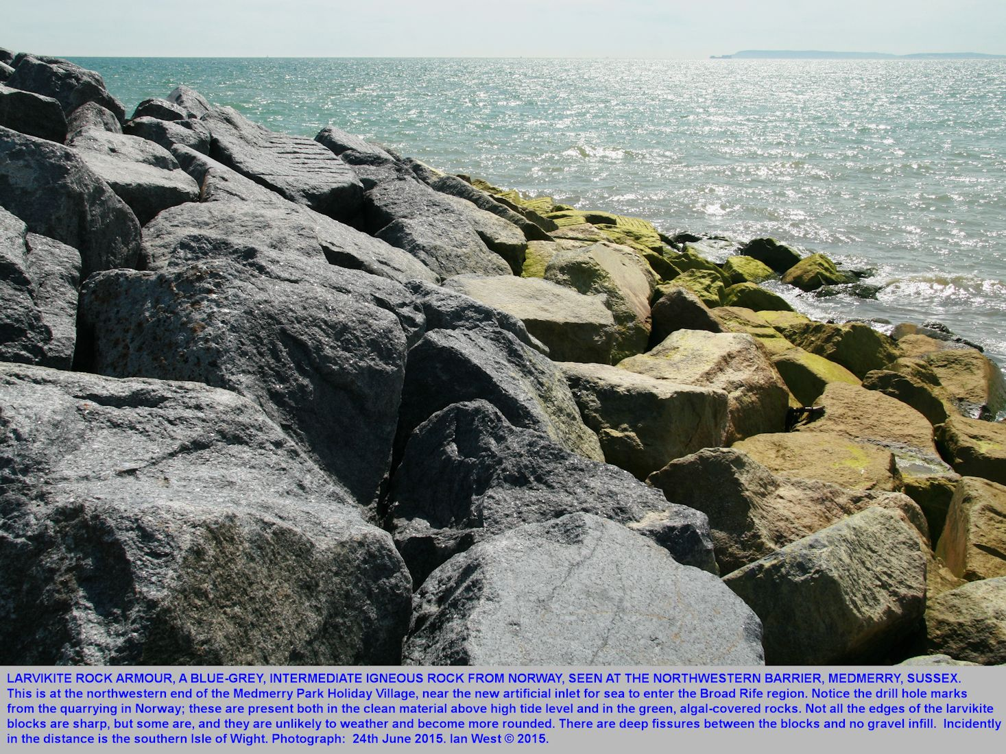 Blocks of larvikite rock armour in the northwestern coastal barrier, not groyne, of Medmerry Park Holiday Village and sea front, Bracklesham Bay, Sussex, 24th June 2015