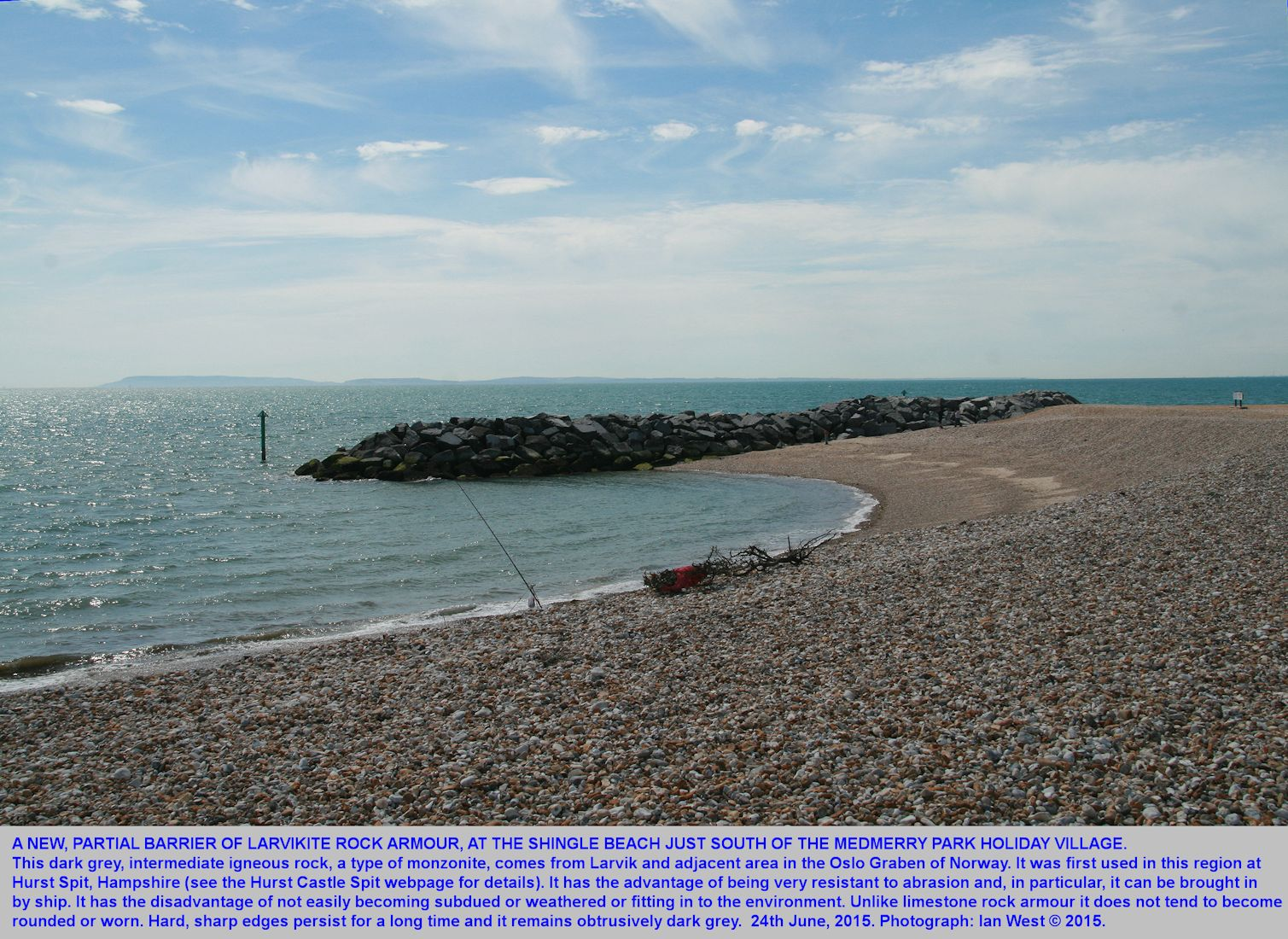 The southern of the two groynes of dark grey larvikite on the beach near Medmerry Park Holiday Village,  Bracklesham Bay, Sussex, 24th June 2015