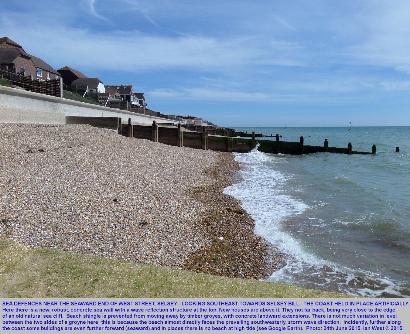 A robust, new concrete wall, and older groynes, are protecting new houses, near the end of West Street, Selsey, Sussex