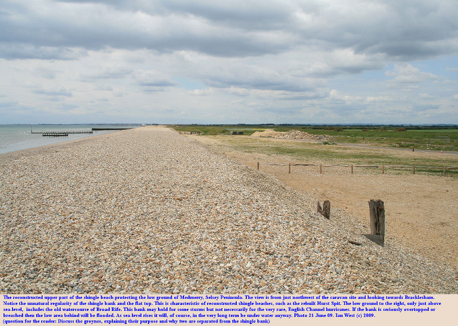 A replenished and reconstructed shingle bank at Medmerry, Selsey, Sussex, showing the low ground around Broad Rife at the back which, although protected in normal conditions, is still at risk of flooding during great storms