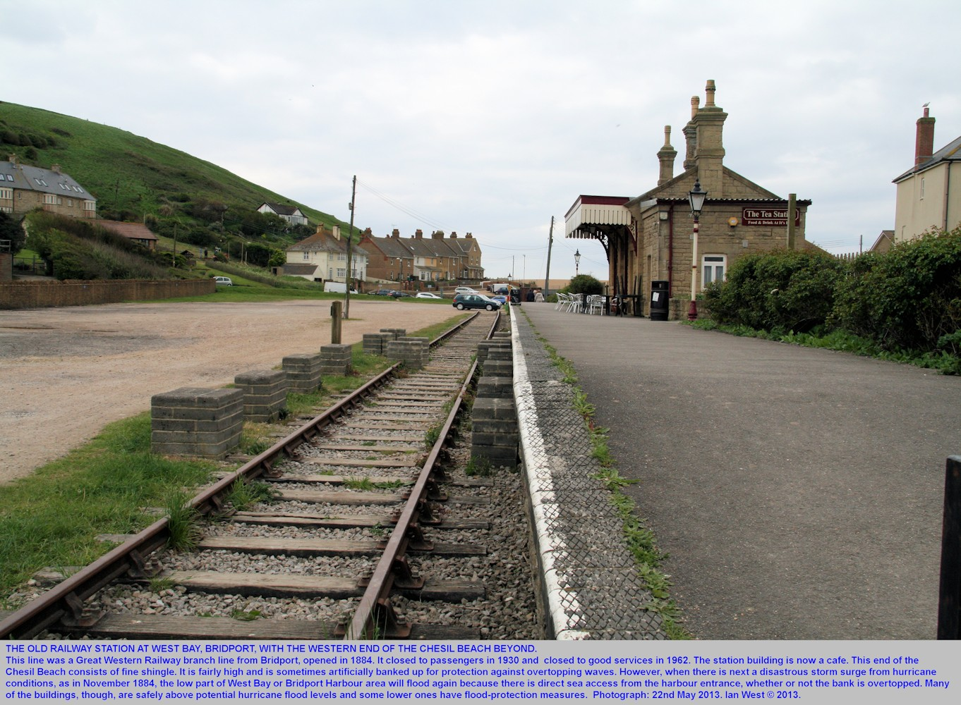 The old railway station at West Bay, Bridport, Dorset, seen in May 2013, with car parking near-by