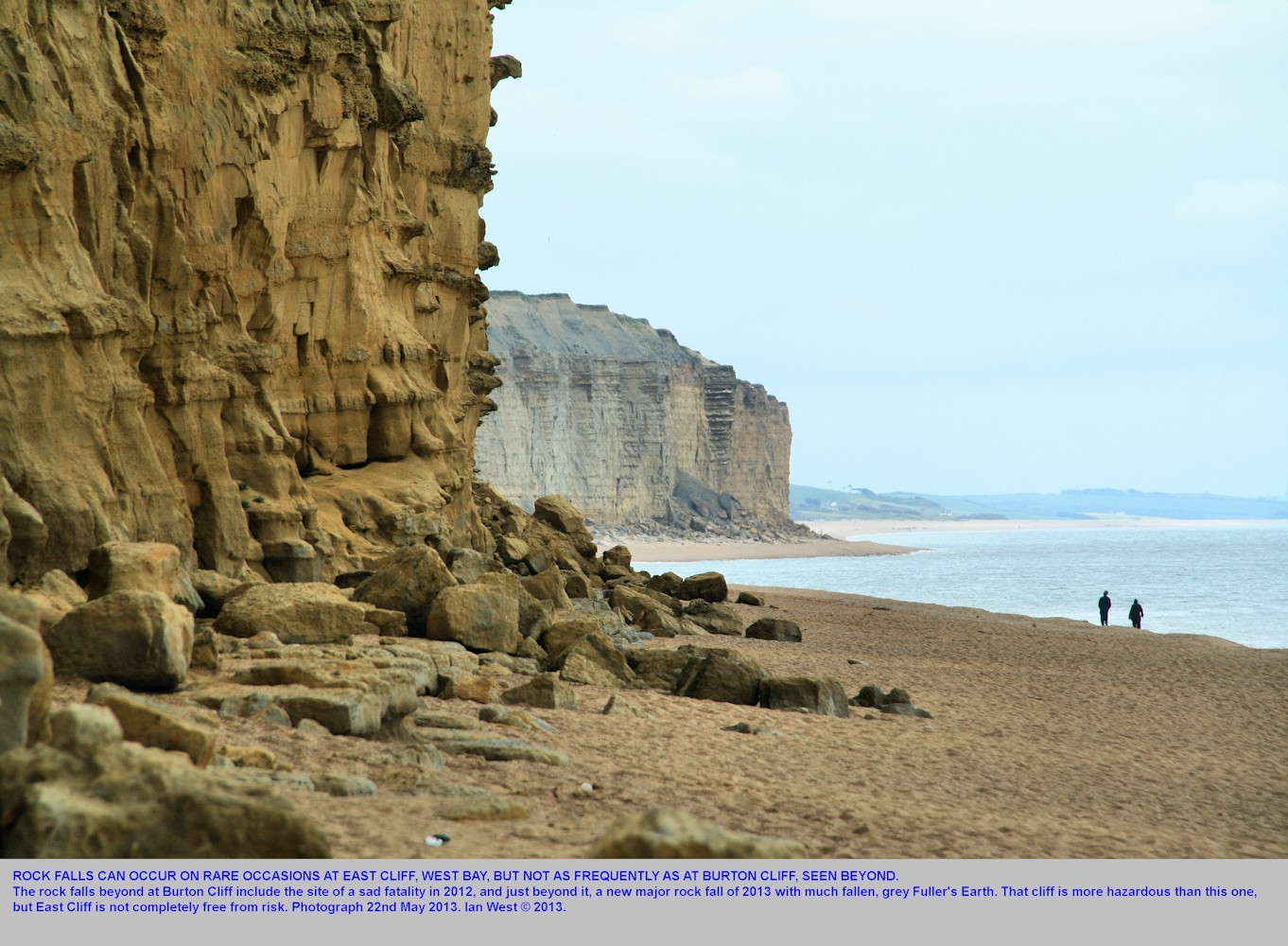 A small rock fall at East Cliff, West Bay, Bridport, Dorset, and a large rock fall at Burton Cliff in the distance, seen on 22nd May 2013