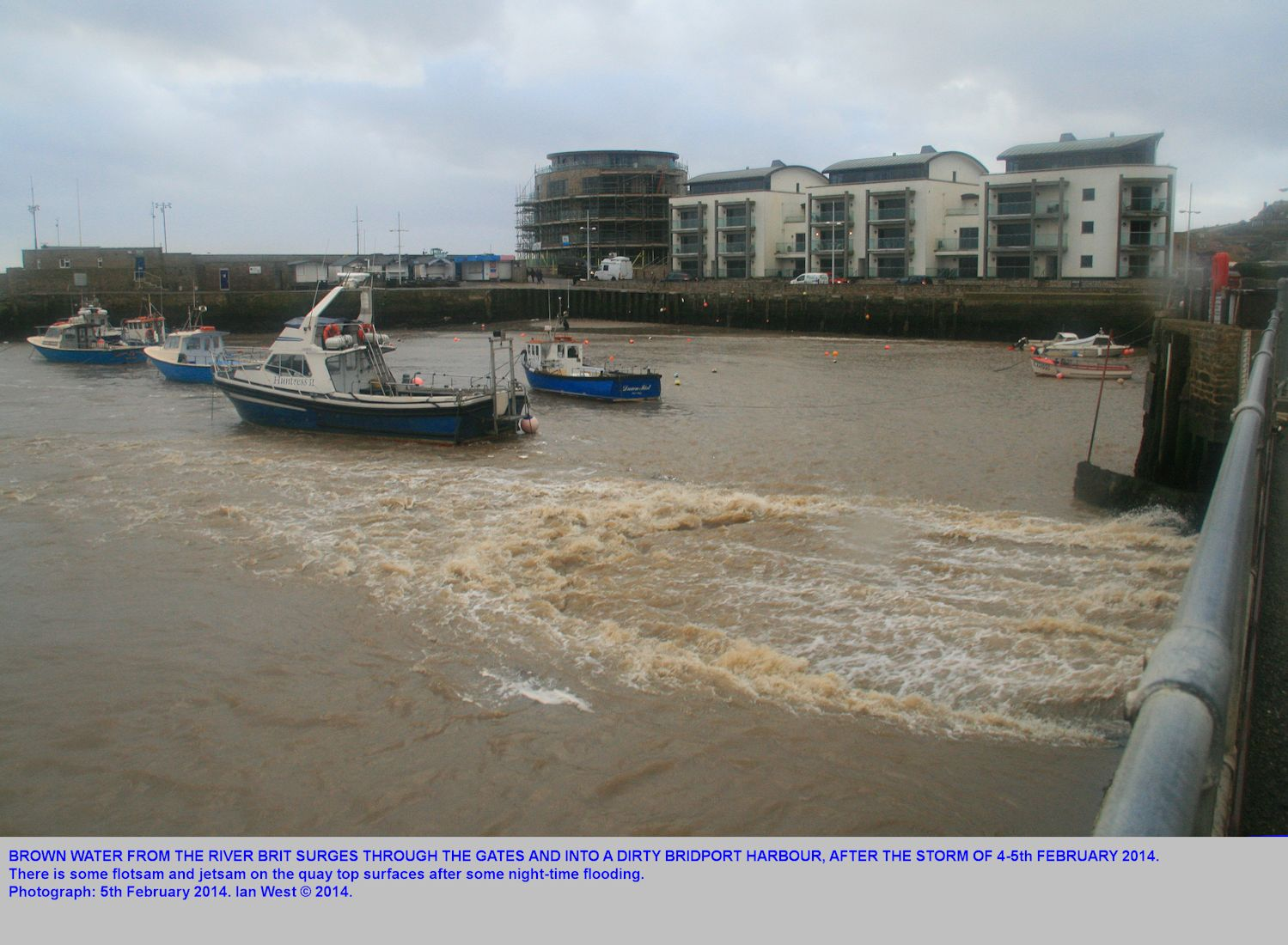 Discharge of brown, muddy water from the River Brit, into Bridport Harbour, West Bay, following the storm in the night of the 4 and 5th of February, 2014.