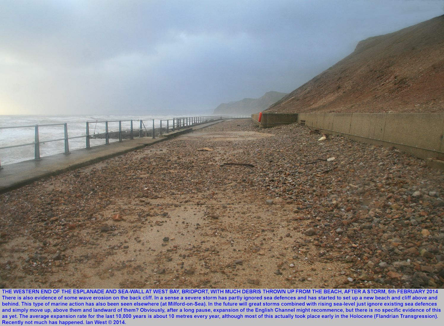 The far western end of the Esplanade and sea wall, at West Bay, Bridport, Dorset, after the storm of the 5th February, 2014, with pebbles thrown up on the roadway