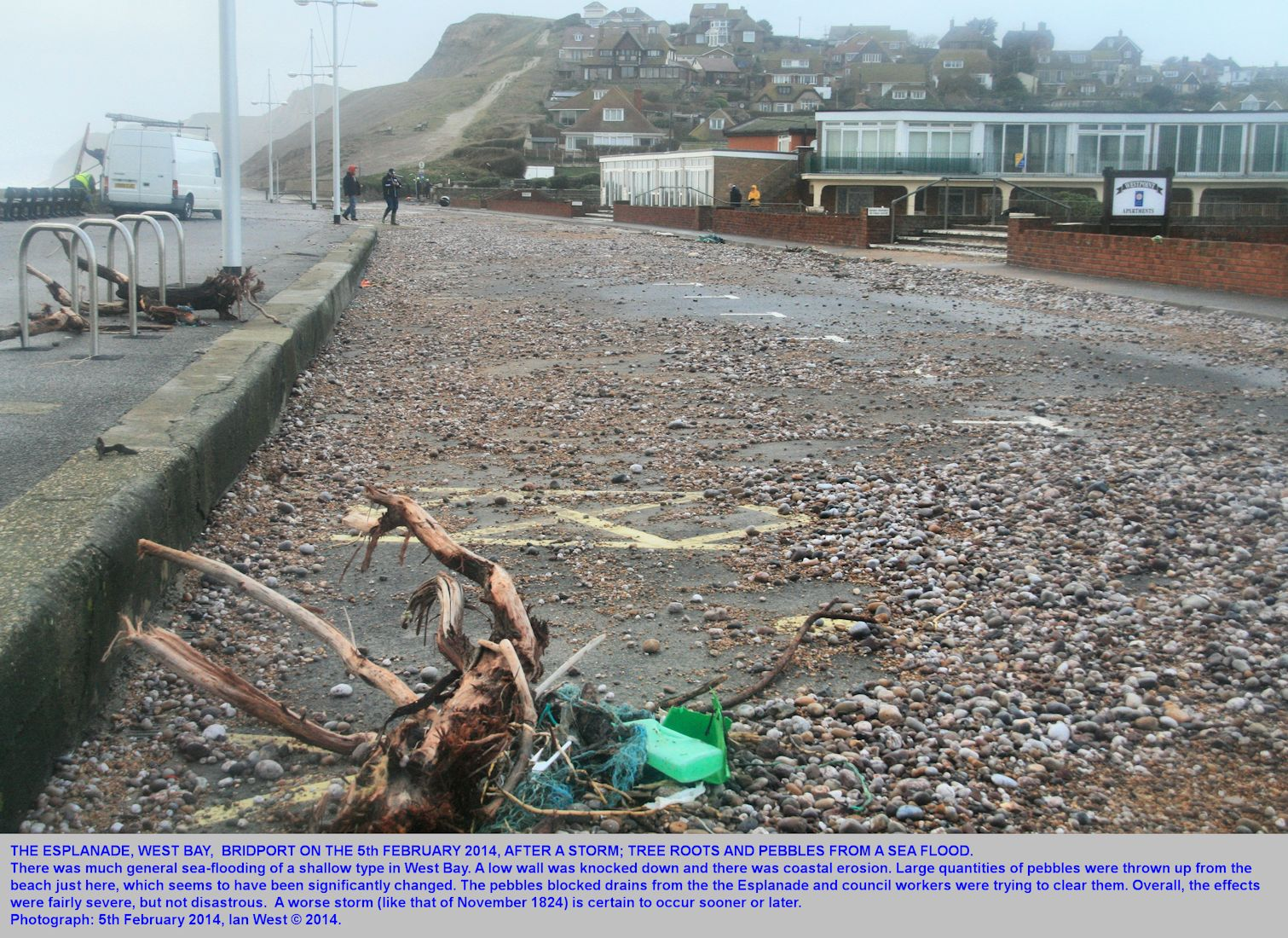 After a bad storm of the night of the 4-5th February 2014, the Esplanade is strewn with pebbles and drift wood, West Bay, Bridport, Dorset