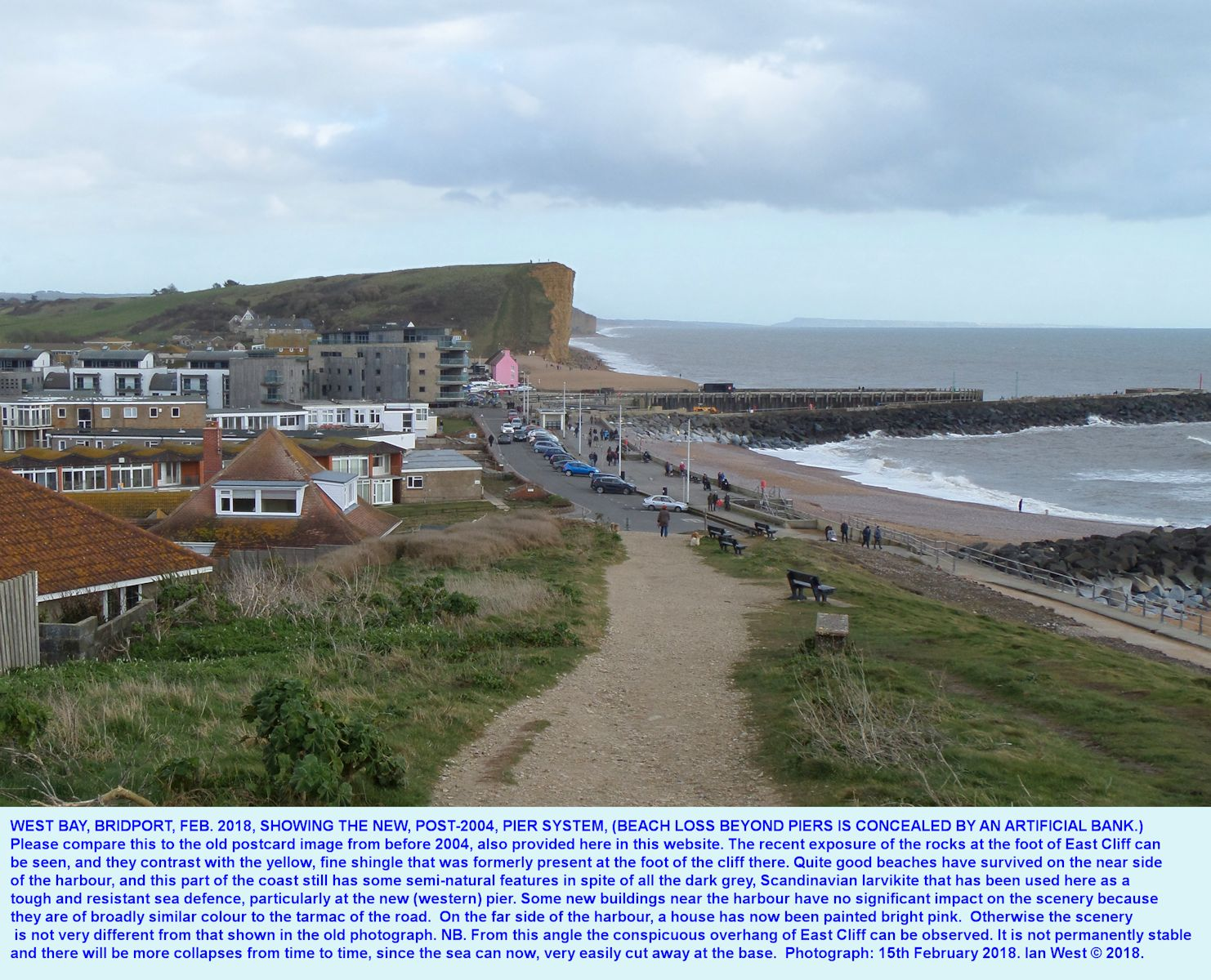 View, of 2018, looking eastward of the piers and harbour entrance of West Bay, Bridport, for comparison with an older photograph, above, from the same location