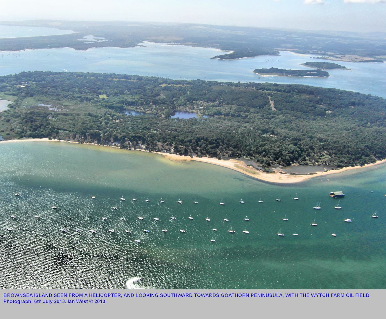 A general view of most of Brownsea Island, Poole Harbour, Dorset, as seen from a helicopter looking southward, 6th July 2013, unlabelled version