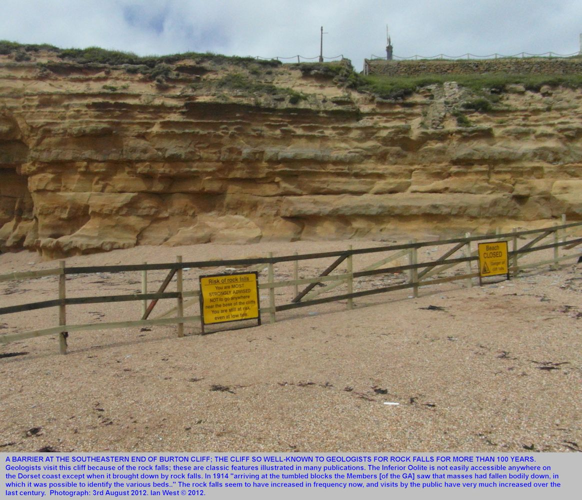 A barrier and an advisory notice regarding rock falls at Burton Cliff, Burton Bradstock, Dorset, at the Hive Beach end, 3rd August 2012