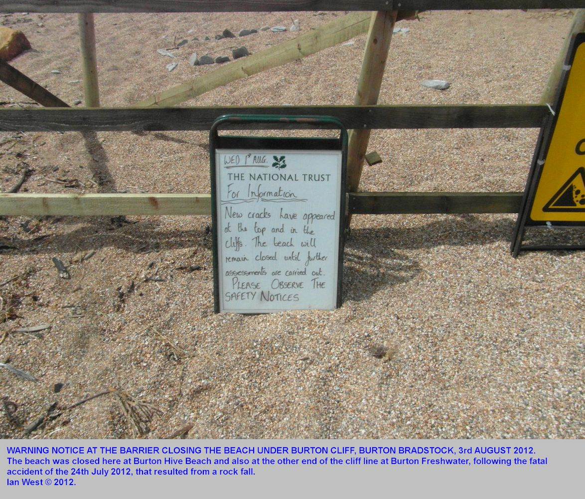 A warning notice about cracks in Burton Cliff, Burton Bradstock, following the fatal accident caused by a rock fall