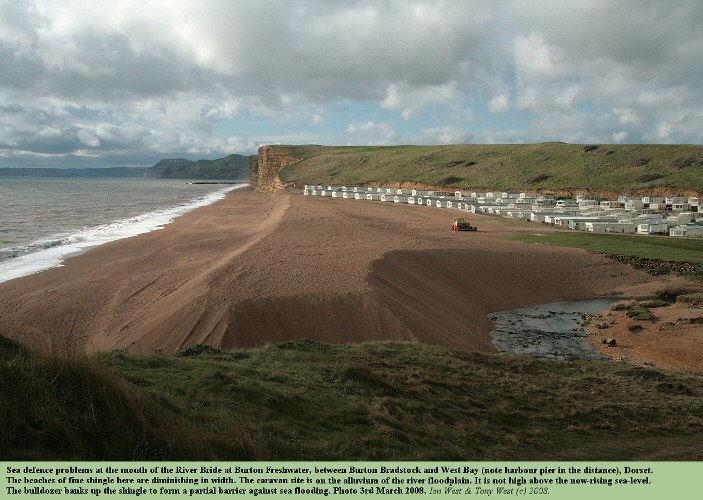 An artificially banked-up barrier of beach shingle to prevent flooding at Burton Freshwater, west of Burton Bradstock, Dorset, 3rd March 2008