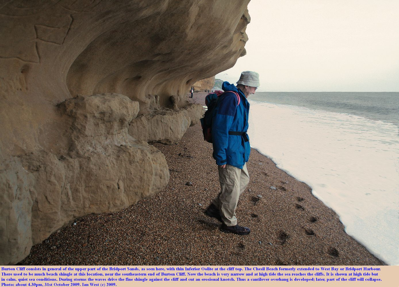 Loss of beach material has resulted in wave action cutting an  overhang or cantilever at the base of the cliff of Bridport Sands at Burton Bradstock, Dorset, as seen 31st October 2009