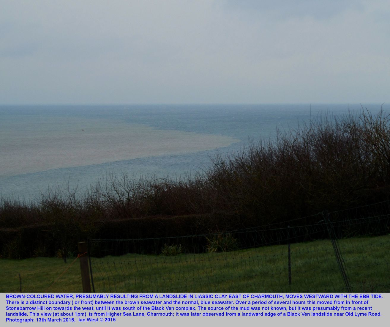 Brown muddy seawater affected by a landslide east of Charmouth and contrasting with blue water further west, Charmouth, Dorset, 13th March 2015