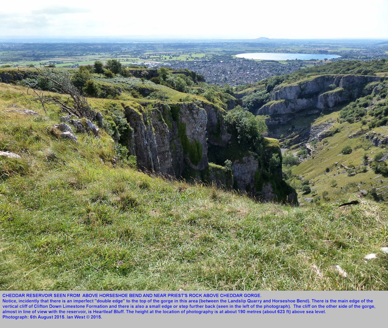 At the cliff top, above Horseshoe Bend, Cheddar Gorge, Mendip Hills, Somerset, with a view of Cheddar Reservoir in the distance