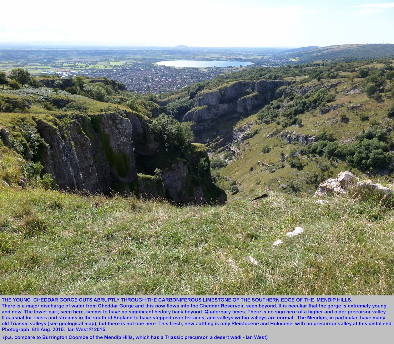 A broad view of Cheddar Gorge and the Cheddar Reservoir, Somerset, from the high cliffs above the south side of the gorge