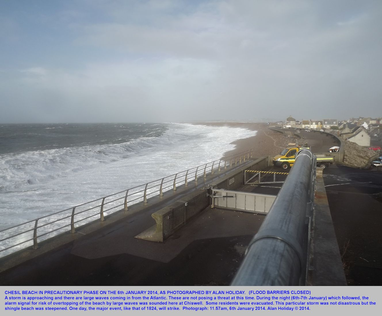 Large waves strike the Chesil Beach, Dorset, in the daytime prior to the major storm of the night of the 6th to 7th January, 2014; sea defence flood gates are closed