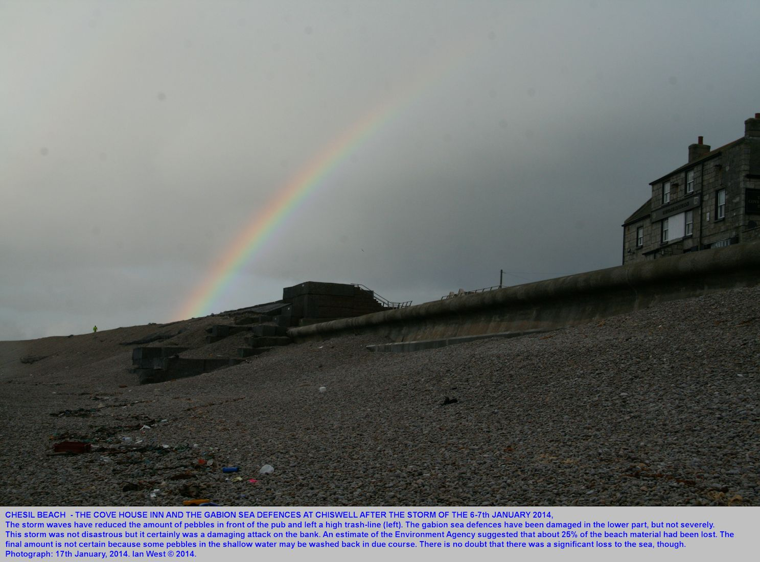 Storm damage on the Chesil Beach in the vicinity of the Cove House Inn, as seen on the 17th January 2014 by Ian West, with a rainbow after a squall