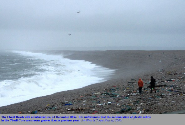 A turbulent sea on the Chesil Beach, Dorset, 31 December 2006, with much plastic debris washed up