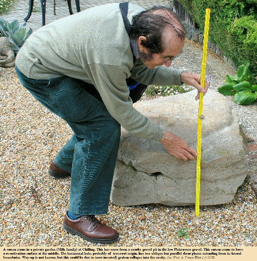 A sarsen stone, with a hole, in a private garden at the village of Chilling, and originally from a gravel pit in the low Pleistocene terrace