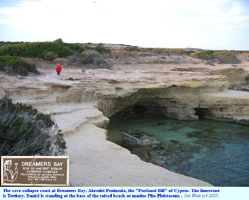 Cave-collapse coast with raised beach or Plio-Pleistocene marine deposits at Dreamers Bay, near Cape Zevgari, Cyprus