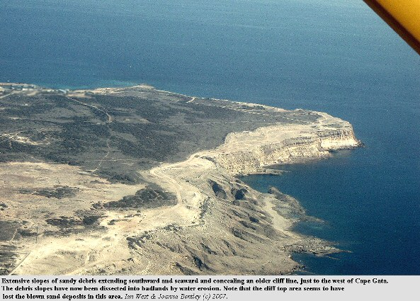 A large area of old landslide debris associated with an old cliff line at the southern cliffs of Akrotiri peninsula, Cyprus, and showing badlands type of water erosion
