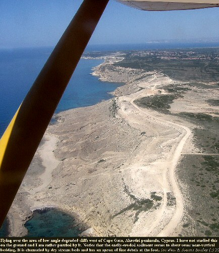 An aerial view of a large area of low angle cliffs of soft, easily-eroded debris, west of Cape Gata, Akrotiri peninsula, Cyprus