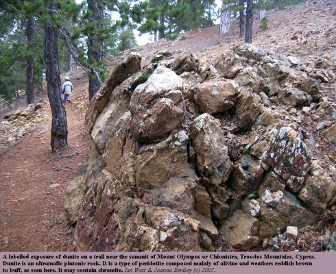 A labelled exposure of dunite on a trail near the summit of Mount Olympus, Chionistra, Troodos Mountains, Cyprus