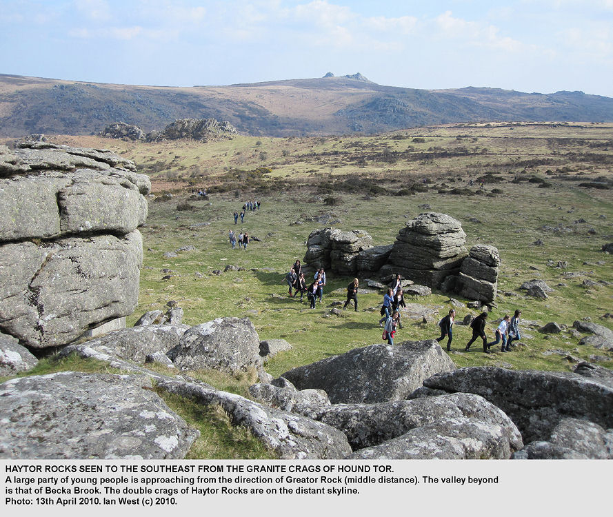 A distant view of Haytor Rocks from Hound Tor, Dartmoor, Devon, with a walking party approaching, 13th April 2010