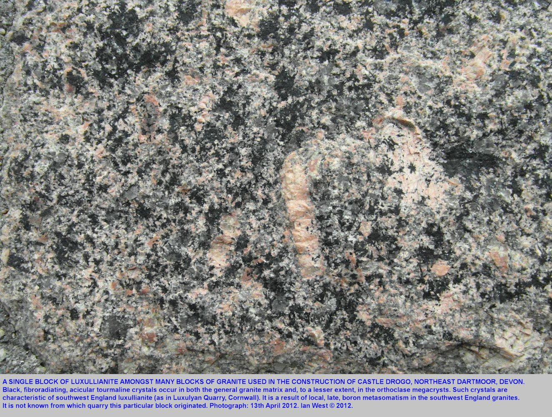 Luxullianite block amongst the granite blocks of Castle Drogo, northeastern Dartmoor, Devon