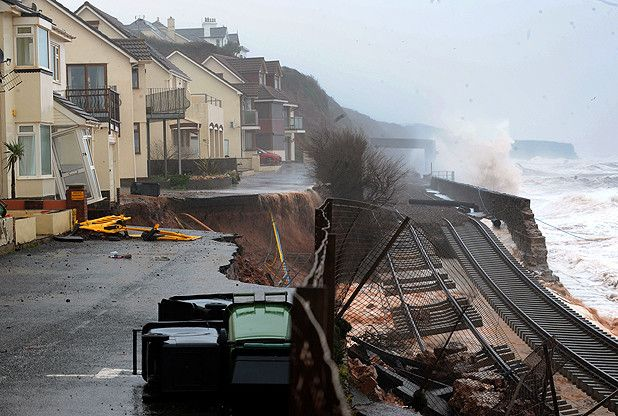 Go to Western Morning News for photographs of breach of the railway line at Dawlish, Devon in 2014