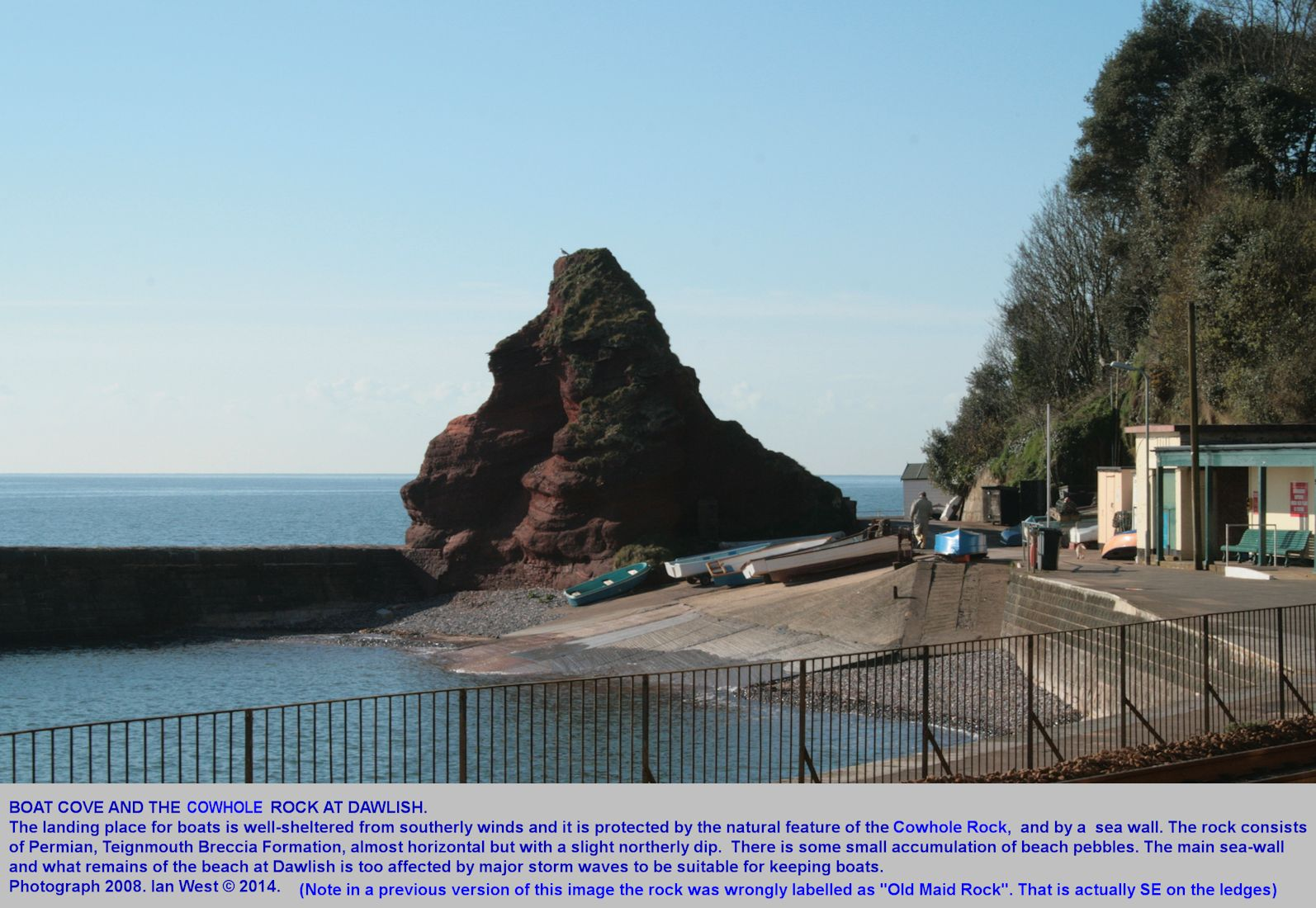Boat Cove and Cowhole Rock, a sea stack of Teignmouth Breccia, incorporated into a sea wall, Dawlish, Devon