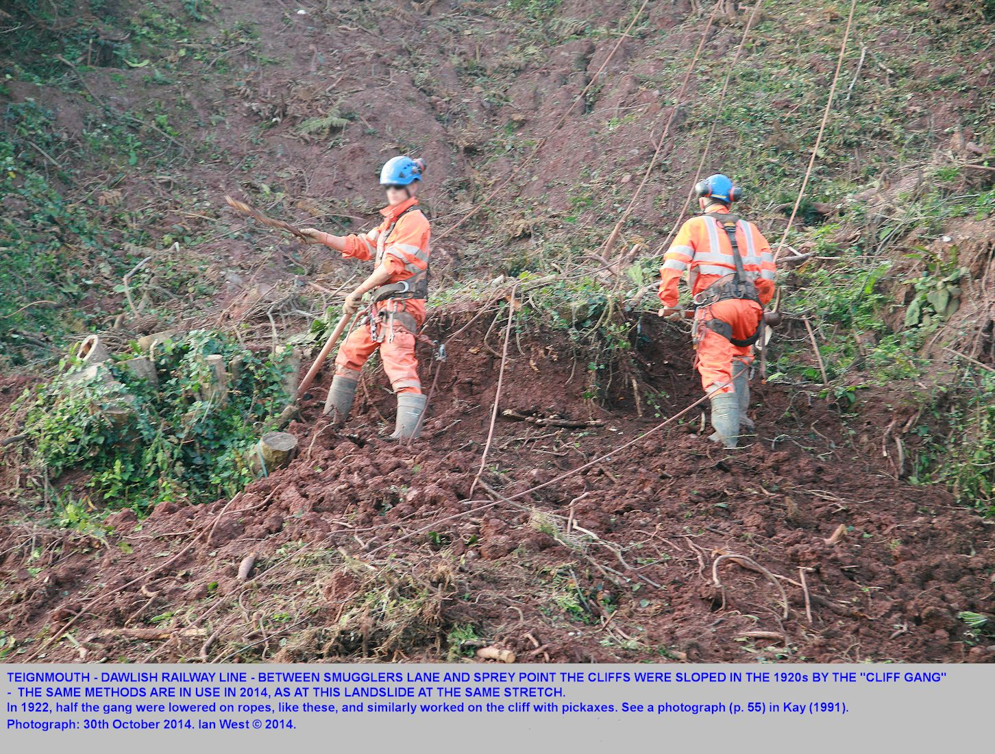 Traditional manual work on a small landslide in the weak cliffs behind the railway line between Sprey Point and Smugglers Lane, Dawlish, Devon, October 2014