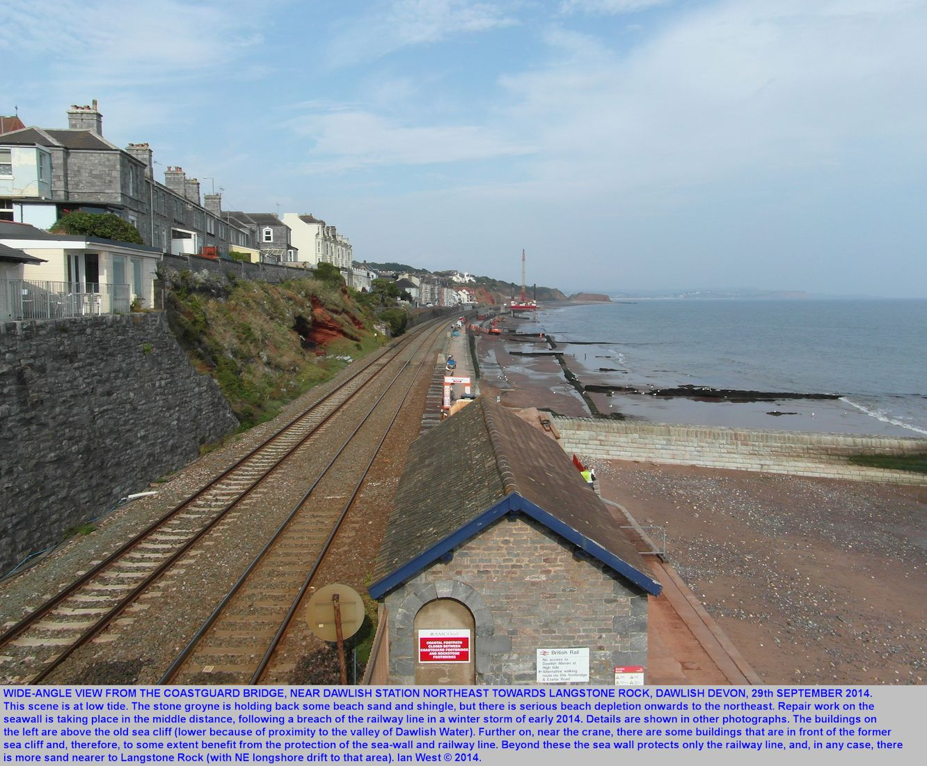 Dawlish, Devon, a wide-angle view from the Coastguard Bridge northeast towards Langstone Rock, showing the area of a breach in the sea wall and railway in February 2014
