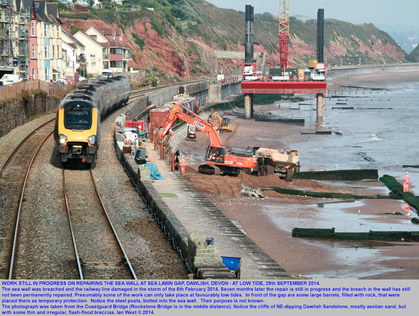Repairs to the railway line at Sea Lawn Gap, Dawlish, Devon, as seen, taking place at low tide, on the 29th September 2014