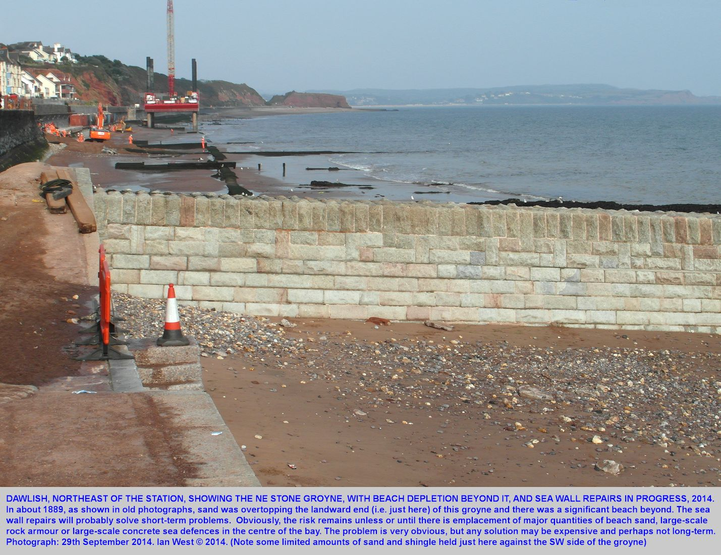 The northeastern stone groyne at Dawlish sea front and beyond the repair works of September 2014 on the former gap in the railway line and sea wall, Dawlish, Devon