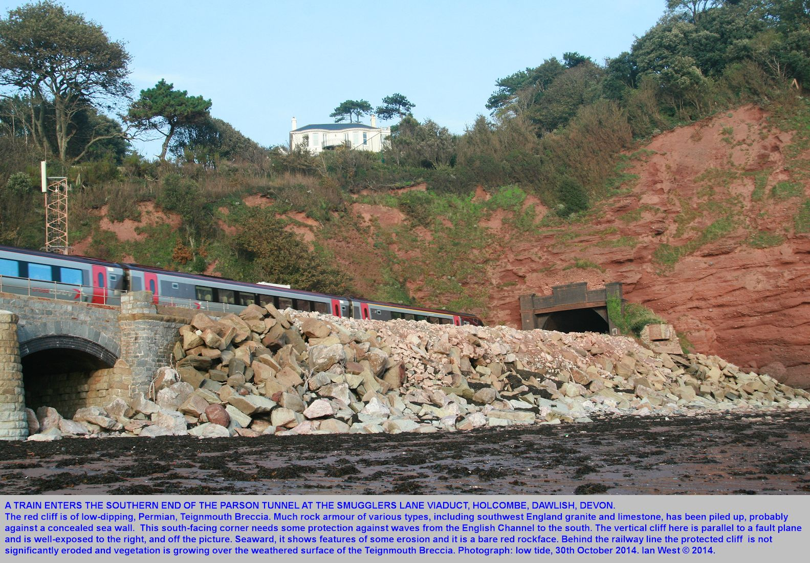A train is about to enter the southern end of the Parson Tunnel at the Smugglers Lane Viaduct, Holcombe, Dawlish, Devon, southern England, 30th October 2014, by Ian West