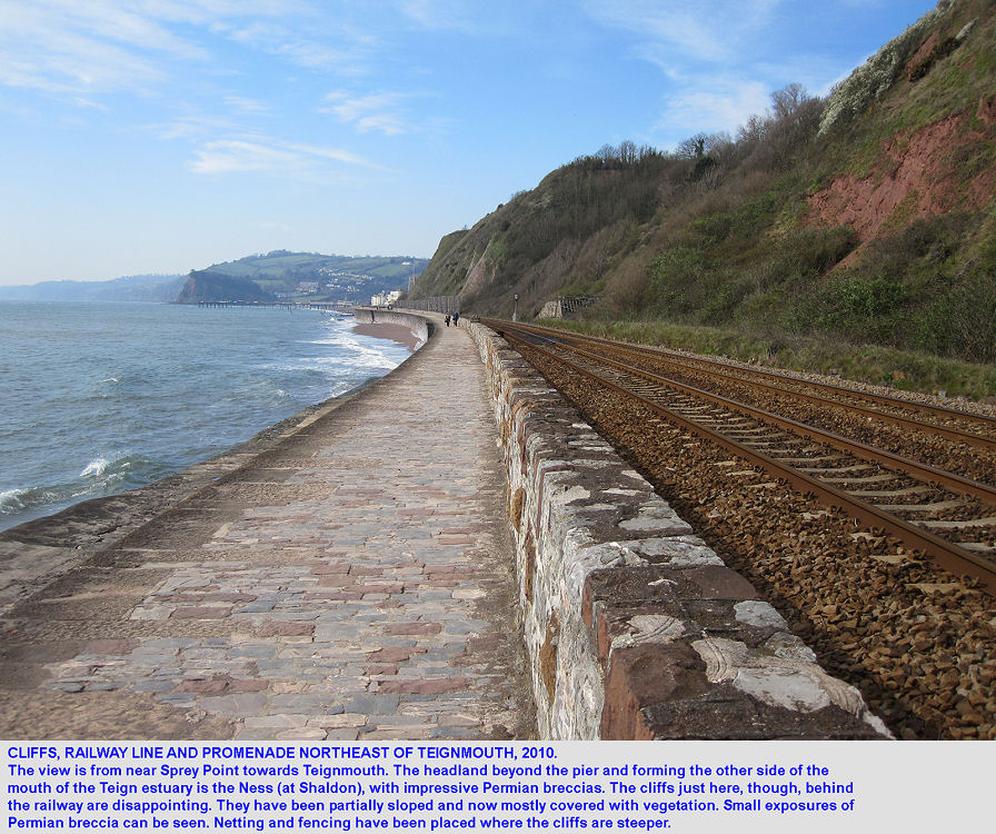 Sea wall, promenade, railway line and cliffs northeast of Teignmouth, Devon, looking towards the Ness at Shaldon, 15th April 2010