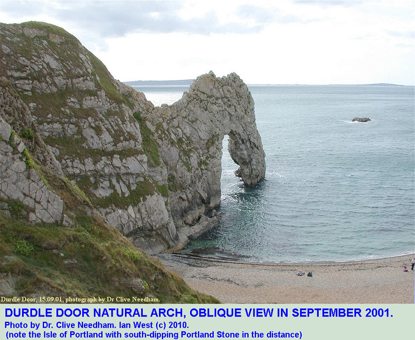 An oblique view of the Durdle Door natural arch, near Lulworth Cove, Dorset, with the Isle of Portland in the distance, photo by Dr Clive Needham, September 2001