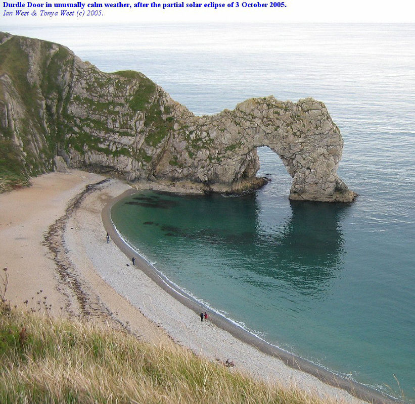 Durdle Door, natural arch in Portland and basal Purbeck limestone, near Lulworth Cove, Dorset, England, seen in calm conditions after partial solar eclipse