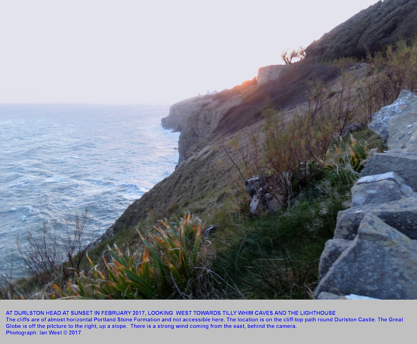 View westward from above Durlston Head, near the Great Globe, towards Tilly Whim Caves, at sunset, February 2017