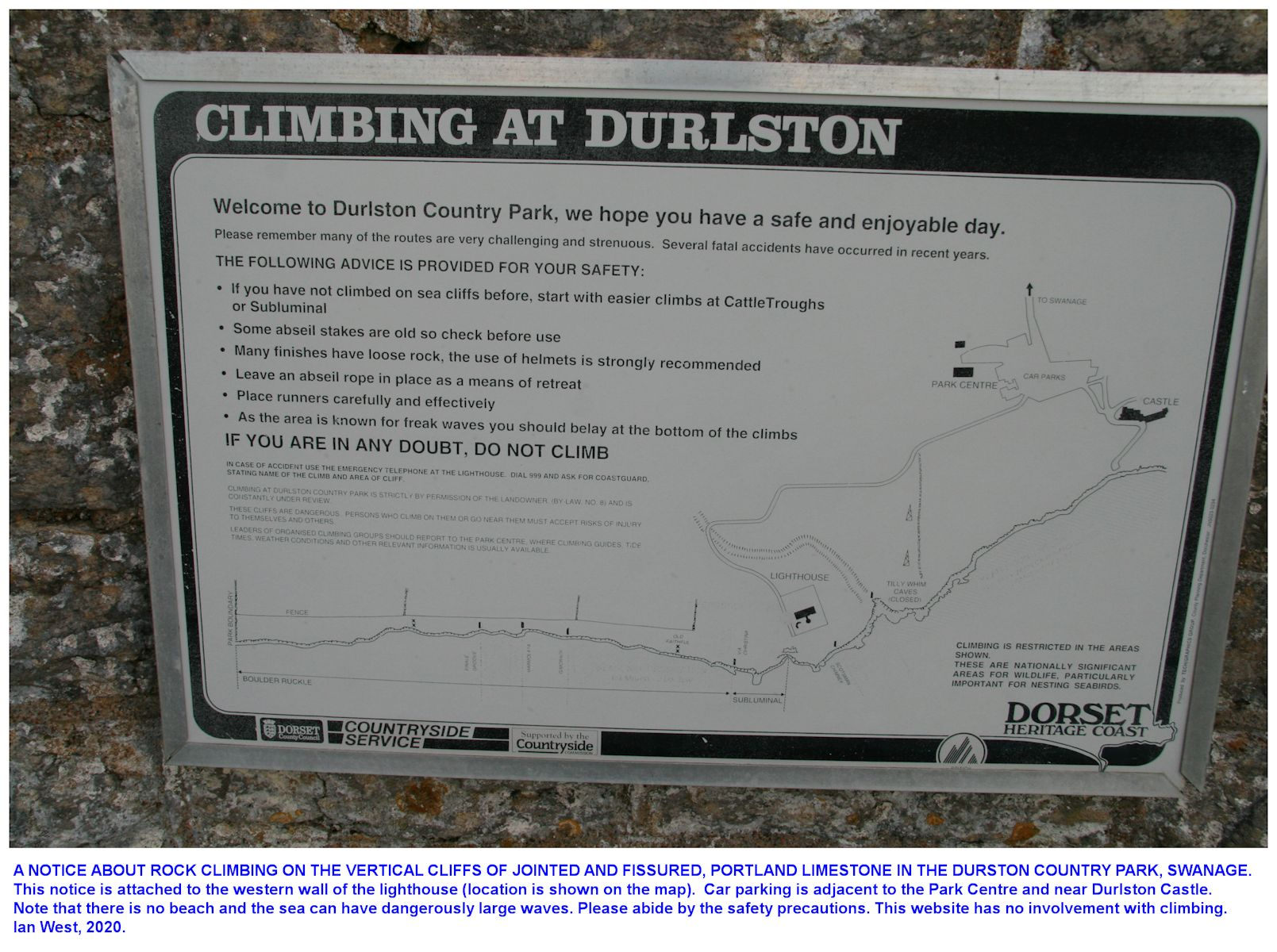 A notice about rock-climbing at the Anvil Point Lighthouse, Swanage, near Durlston Head, Dorset, southern England, December 2019
