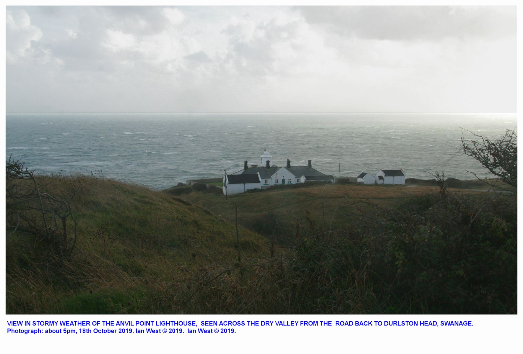 The location of the Anvil Point lighthouse, as seen from the narrow road heading back to Durlston Head, stormy weather, 18th October 2019