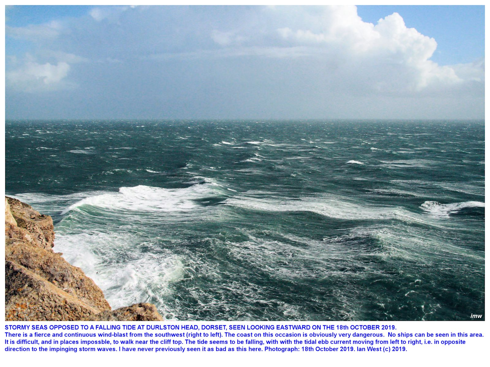 Very large waves, of long wave-length, moving northeastward and in the opposite direction to the outflow current of a falling tide, in severe storm conditions at Durlston Head, Dorset, 18th October 2019, Ian West