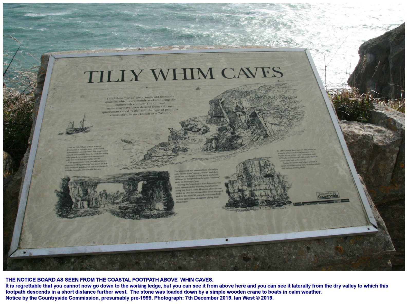 An informative notice board on the cliff-top path above the Tilly Whim Caves, quarry ledge, west of Durlston Head, Isle of Purbeck, Dorset, as in December 2019, Ian West
