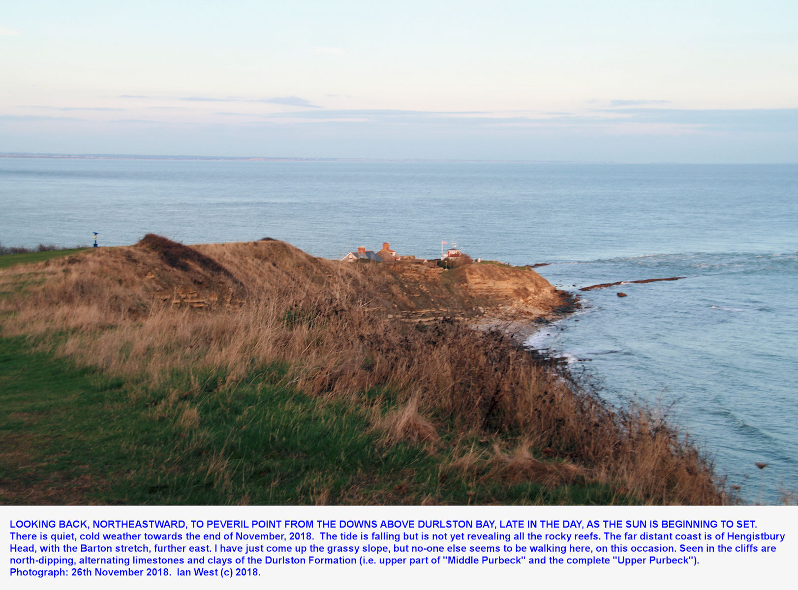 Looking down from the higher cliff top on the Downs towards  the Peveril Point promontory, at sunset, 26th November 2018